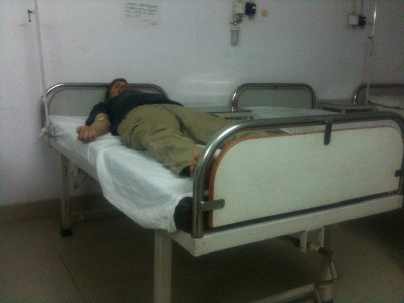 The author lying exhausted in a Darjeeling hospital after a blood test