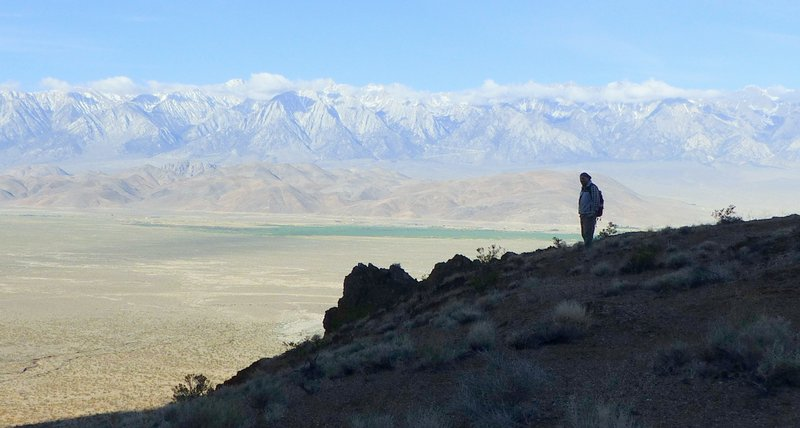 Matt Dagrosa n the Inyo Mountains, with Owens Valley and the Sierra Nevadas in the background